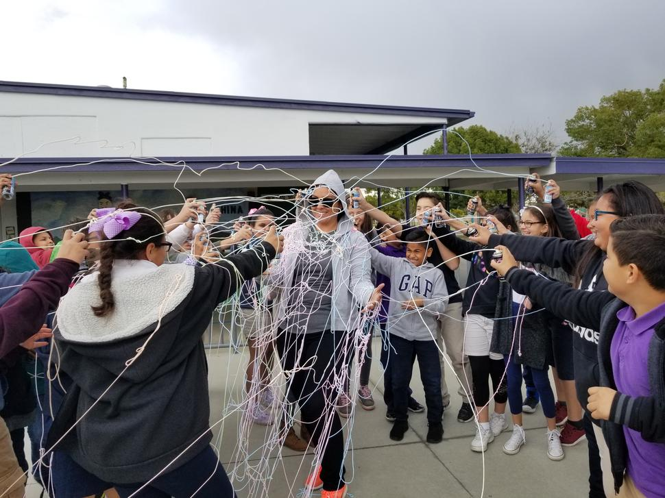 Ms. Avila's students silly string her because they raised the most amount of  money!
